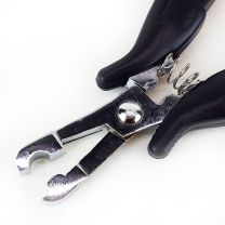Close up of metal u-tip on pliers for making fusion hair extension tips