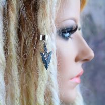 Silver metal tribal arrowhead charm dread cuff on model with blonde dreadlocks