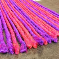 Hot pink and bright purple synthetic dreadlocks backcombed formed and single end loop top