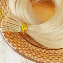 Close up of 50 strand bundle keratin prebond 3mm tips Bliss I-Tip hair extensions